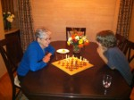 Eric is teaching me during my very first game of chess. He let me beat him, bless his heart.